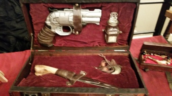 Werewolf Hunter's Kit. Gun (refinished plastic dart gun - still works), glass jar with wolfsbane, trophy claw necklace and silvered knife. $125