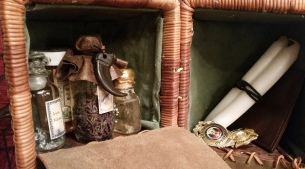 Inside the monster hunter's backpack. Quick and easy monster repellent, candles, badges.