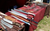 Nathaniel's wooden weapons, in all kinds of shapes and sizes, wait for their new homes.