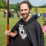 Happy customer with our horn-tipped spear, black fleece cloak, and short crystal wand.